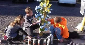Daniel Tillison's children help set up a memorial for him in the place where he died. —Photo courtesy of Mary Jobe